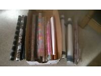 Over 20 rolls and part rolls of quality cellophane gift wrapping plus pro cutter