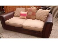Can deliver quality half leather half fabric 3 seater sofa in good condition