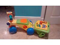 Tomy toddle'n ride - walker/bike