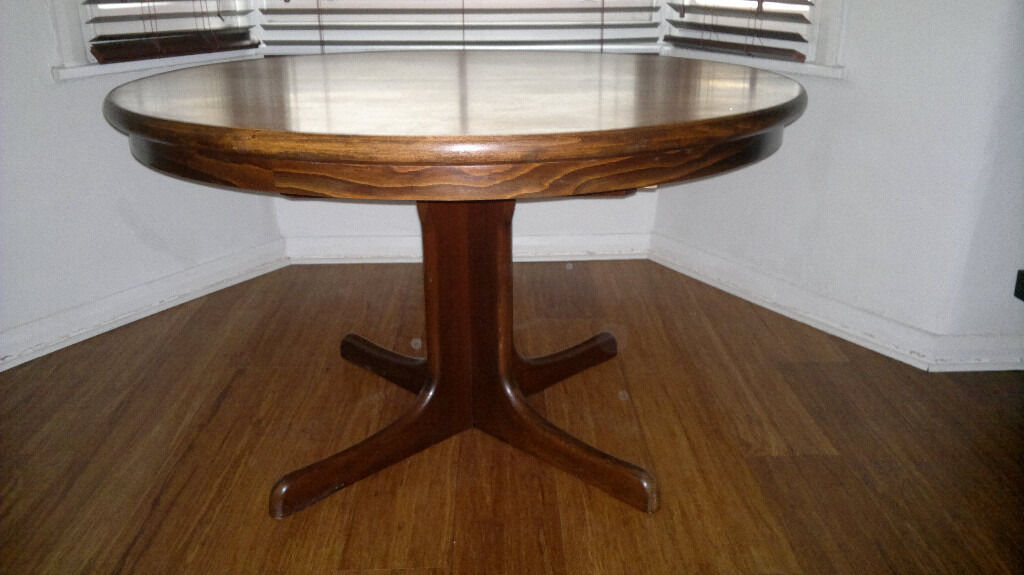 1960s round extending dining table with 2 retractable leaves in