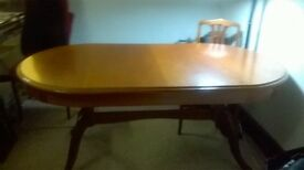Dining table and 6 matching chairs with extending leaf.