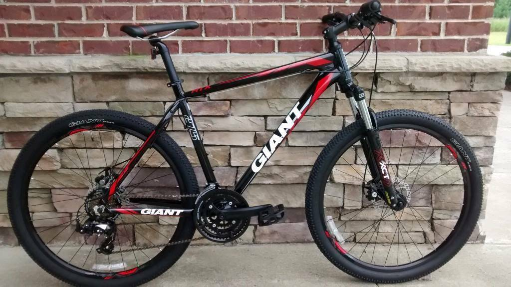 2 X Giant Atx 27 5 2 Hard Tail Mountain Bikes And Bike Rack For Sale