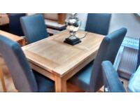 Stunning chunky oak extending dining table and chairs