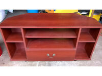 Medium wood TV unit or cabinet withstorage shelves and drawer.
