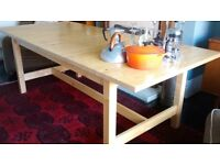 Extendable, solid wood dining table for sale. Sits up to 10 people. Good condition.