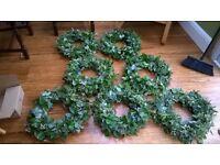ten green plastic wreath bases, with green foam