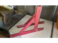 a pair of two metal gallows brackets
