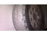 Two Michelin 4x4 Radial tires on white 6 lug wheels. 235/70 R16
