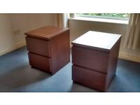 2 brown wood bedside tables