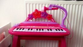 Kids pink keyboard/piano