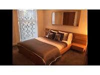 Malim double bed with bedside cabinets