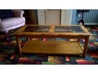Light wood glass topped coffee table with shelf. £50