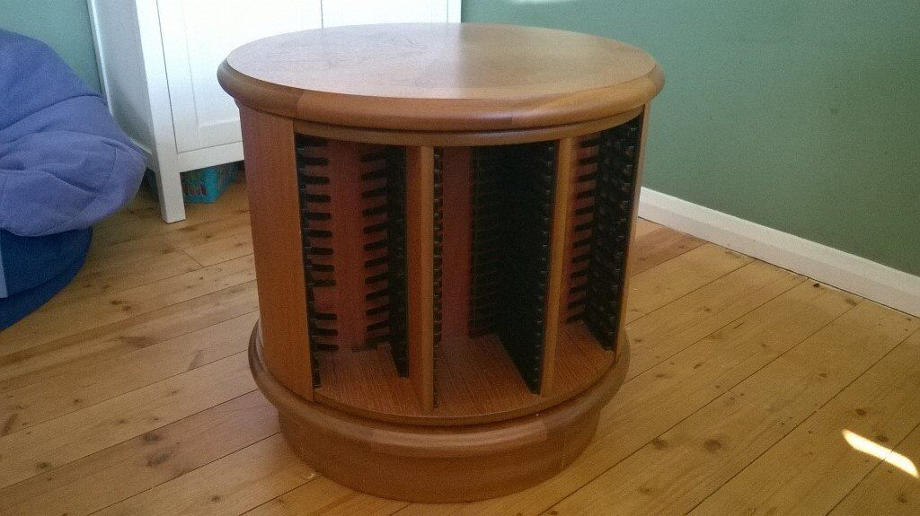 Coffee table with revolving cd rack made by nathan teak for Revolving end table
