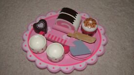 Girl's wooden afternoon tea toy set