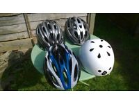 Bike helmets four nearly new medium and large