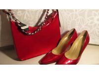 New Russell & Bromley Sexy High heel shoes in Metallic Red/matching Bag. Size 38