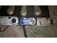 Three, yes 3! Sony Cyber Shot digital cameras.