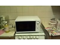microwave oven 4 weeks old five pounds