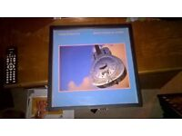 Brothers in Arms.. Dire Straits vinyl record in black frame..