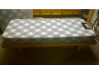 Single bed wooden base and sprung mattress