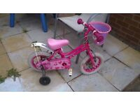Girls pink barbie bike with stabilizers and basket