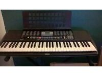 Yamaha Electric Keyboard with black stand