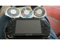 PSP with games and carry case