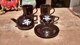 Tea/coffee pot, matching cup and saucer, 2 matching black mugs, good condition, Porthtowan