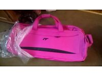 IT luggage from House of Fraser, large pull along bags, one pink, one black and one purple