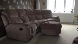 Brown curved sofa and footstool