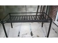Glass top metal dining table and 4 chairs