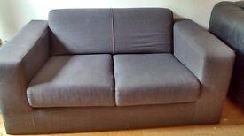 Grey textile two seater sofa