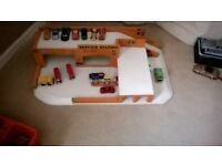 toy garage with vehicles