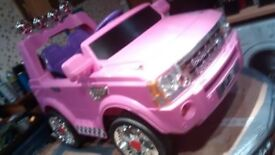 A 12 volt Electric ride on Land rover style Jeep in pink