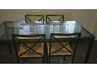 Glass Dinning table with four chairs