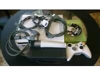 XBOX 360 WITH WIFI ADAPTER , MICROPHONE AND 4 GAMES