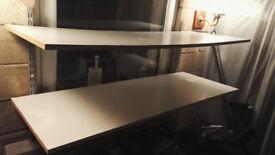 2 large white wooden shelves on metal brackets