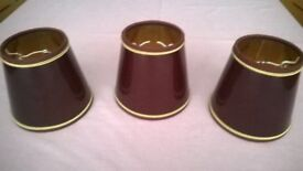 Burgundy lamp shades - set of 3 with gold trim Height approx 12cm Collection only