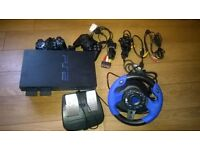 PS2,2 controllers,steering wheel and 15 games