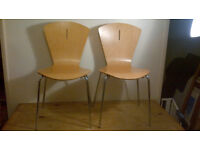 2 PINE & METAL CHAIRS (THEY ARE THE SAME COLOUR ITS JUST THE LIGHT IS ON 1 SIDE) LITTLE WEAR & TEAR