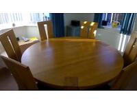 modern round dining table with 6 chairs 160cm across. Solid oak. sale due to downsizing