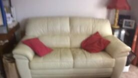 """2 Piece suite: sofa 68"""" long, 36"""" high, chair 34"""" long, 33"""" high. Both in ivory leather style."""