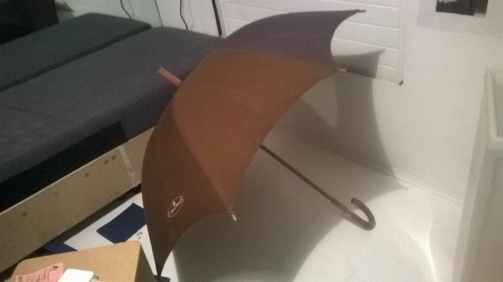 """Cotton umbrella with wooden handle excellent central London bargainin West End, LondonGumtree - Cotton and wood umbrella with leather cap, in excellent condition. A bargain at £10, easy to pick up from my central London location with free parking and click on """"See all ads"""" link for everything else I am selling in this clearance"""