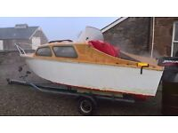 Outboard boat and trailer