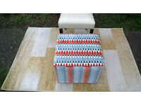 A New Ashley Manor Cube Fabric Material Footstool.