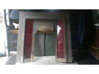 Cast iron fireplace insert with Art Nouveau pattern hood