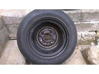 """12""""Space saver spare wheel with 4 stud pattern and Dunlop Tyre"""