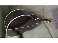 Takamine acoustic guitar with hardcase. model GN5ICE-BSB. Some light scratching. Daion hard case.