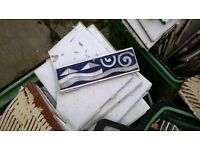 Job lot of used white tiles and blue boarder tiles