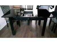 Black gloss dining table with chairs